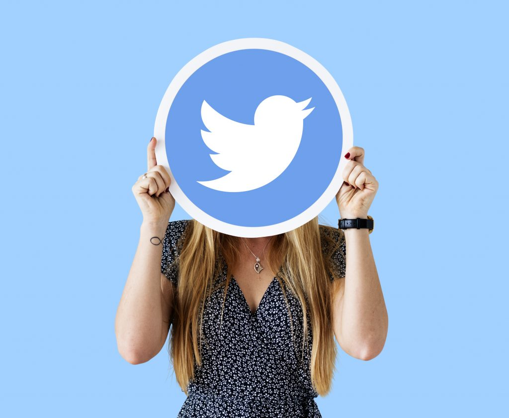 Woman showing a Twitter icon